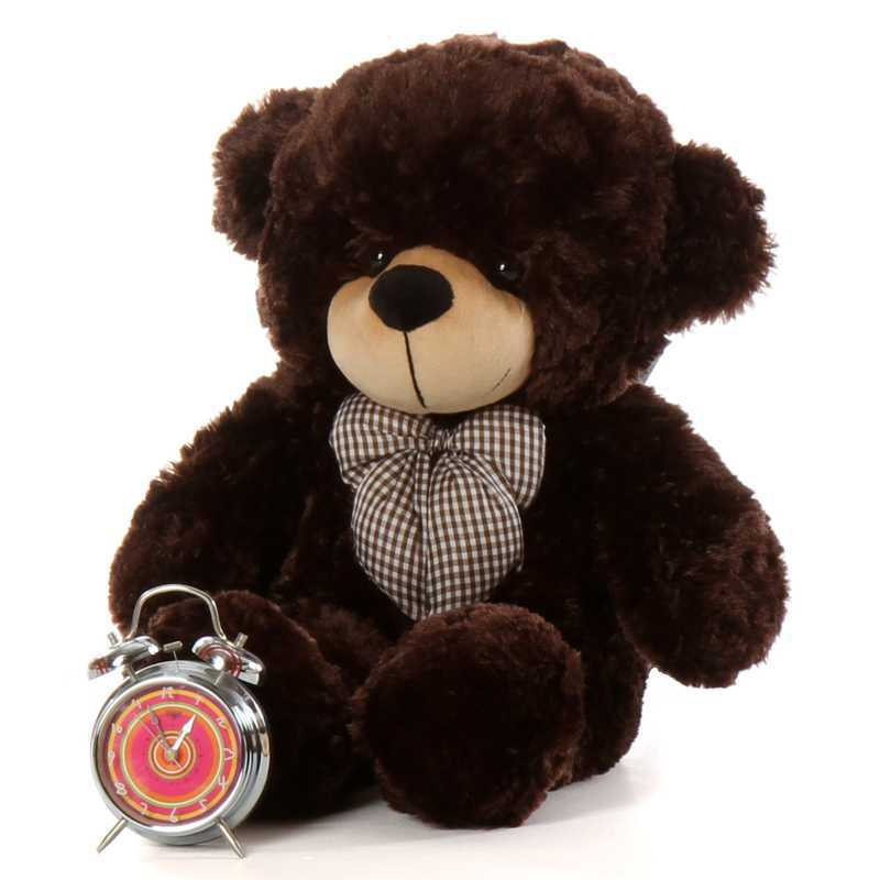 Big brown teddy bear with red bow