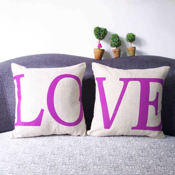 LO and VE printed in purple LOVE couple cushions